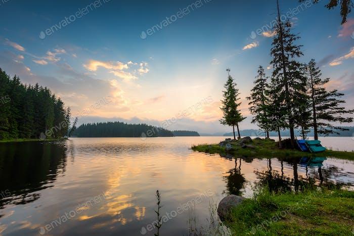 Mountain lake sunset with beautiful reflections