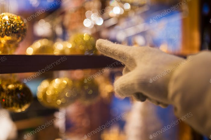 Thumbnail for hand pointing at christmas toys behind shop window