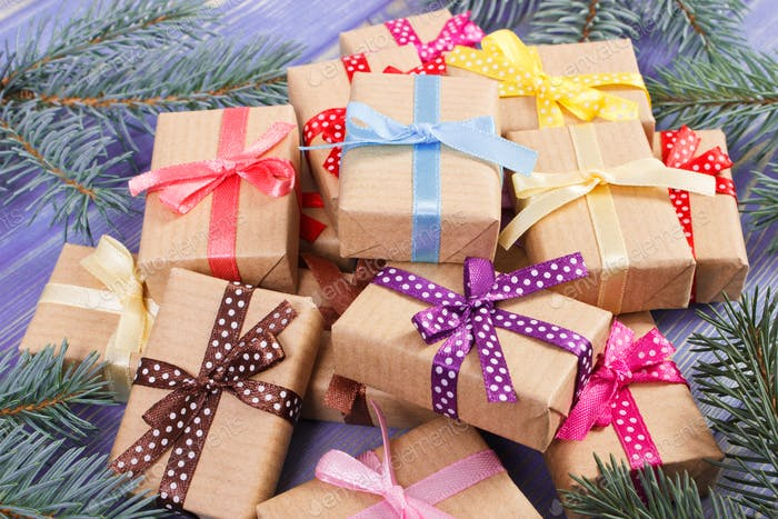 Wrapped gifts with colorful ribbons for Christmas and spruce branches