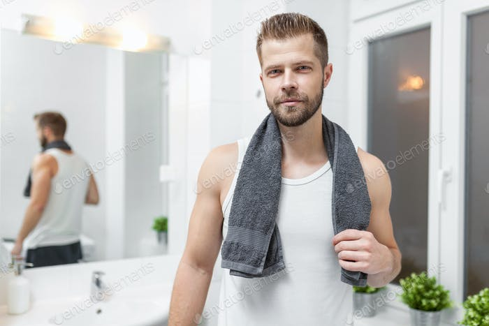 Morning hygiene, Man in the bathroom looking in mirror