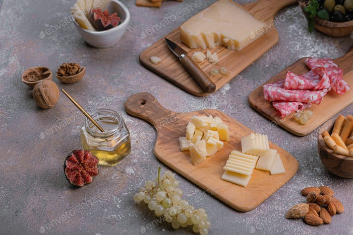 Tiny boards full of cheese, salumi, nuts and grapes