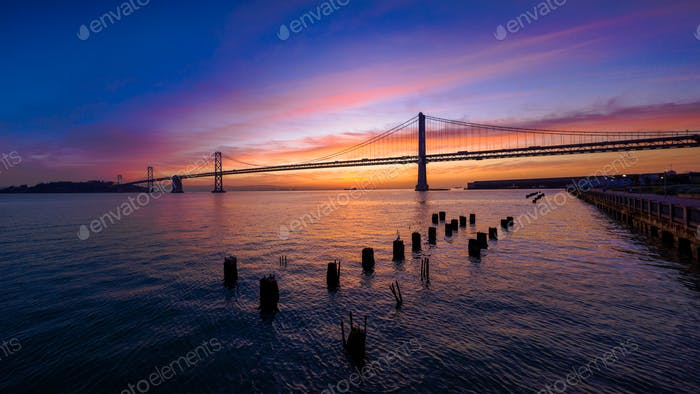 San Francisco-Oakland Bay Bridge at Sunrise with Colorful Clouds