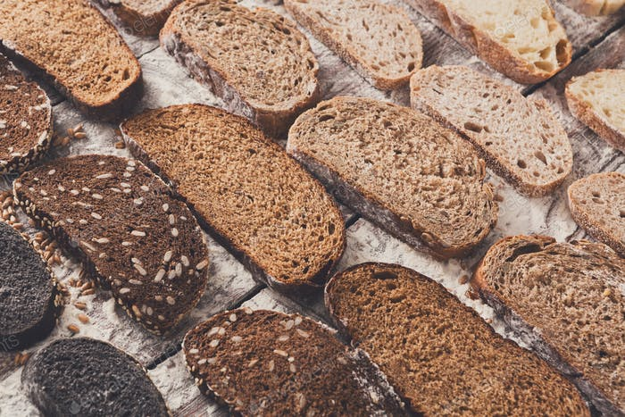 Bäckerei Konzept. Viel geschnittenes Brot Hintergrund