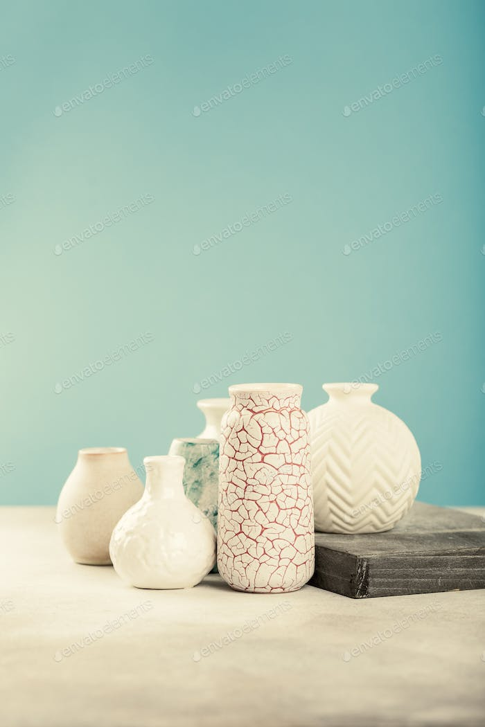 Various light colored vases