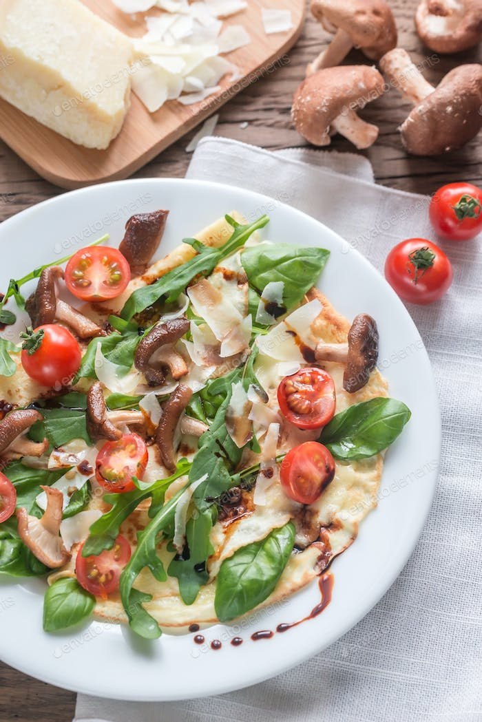 Crepes with cherry tomatoes, cheese, mushrooms and arugula