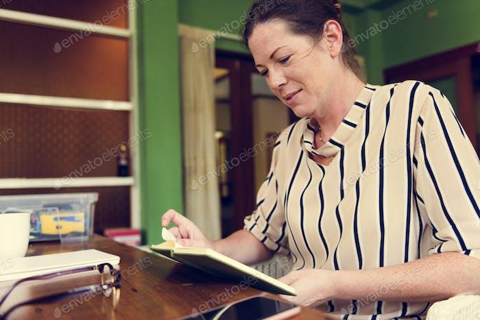 Caucasian woman reading a book