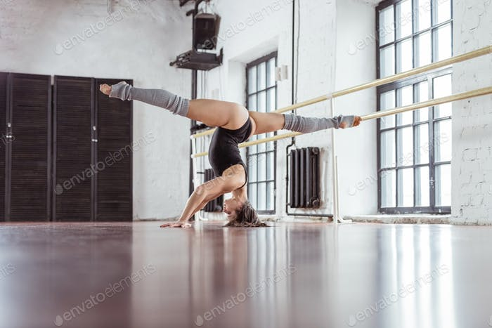 Young dancer on training in dance studio