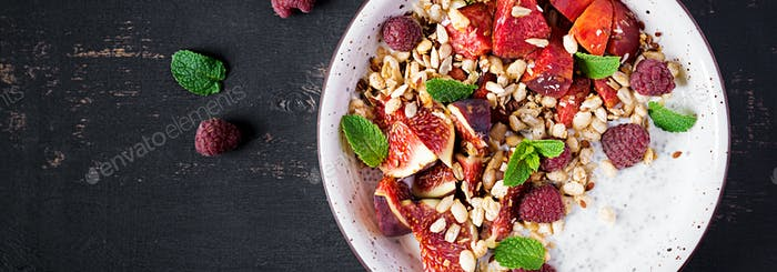 Chia seed pudding made with raspberries,  figs and mint on dark