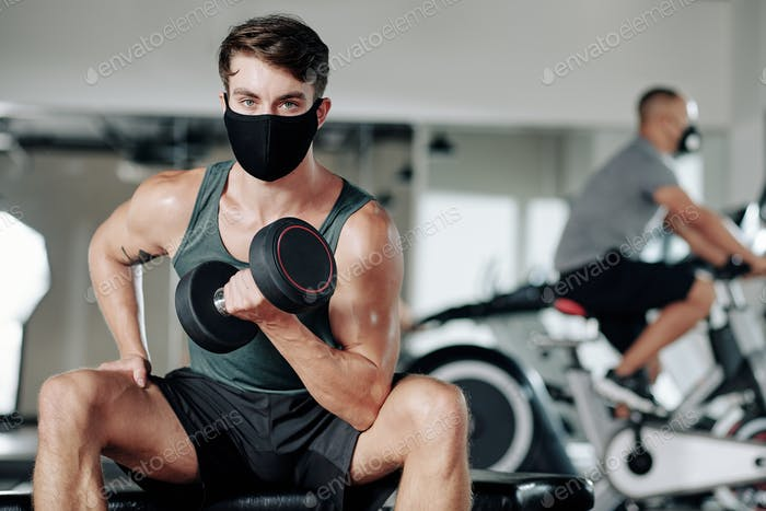Man exercising in protective mask