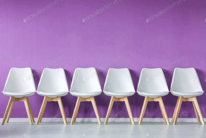 Row of chairs against wall