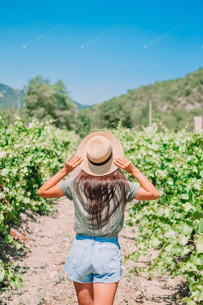 Woman in the vineyard in sun day