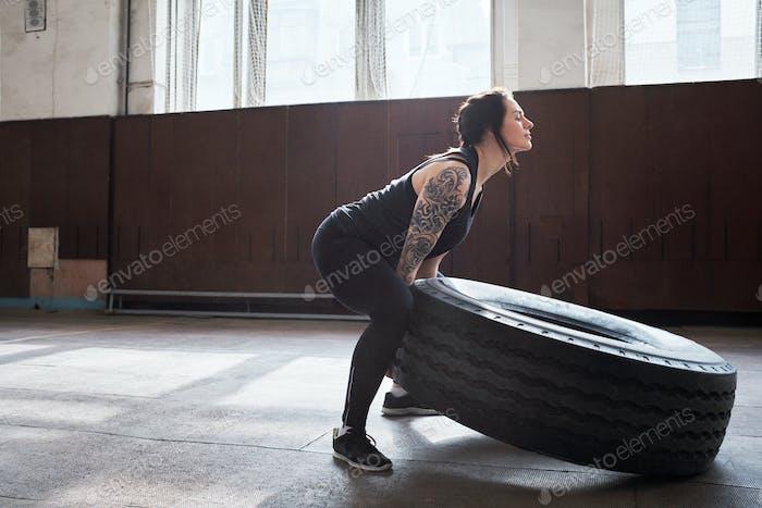 Sportswoman building muscles
