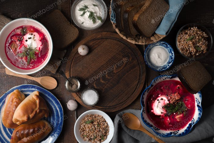 Traditional Russian dishes on the wooden table horizontal