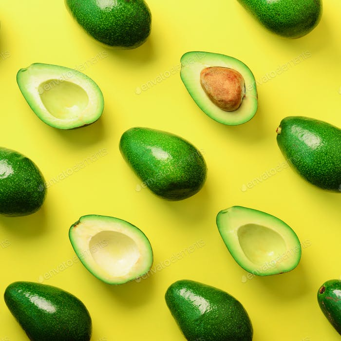 Avocado pattern on yellow background. Top view. Banner. Pop art design, creative summer food concept