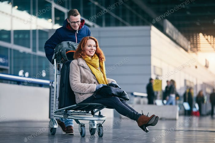 Cheerful couple travel together