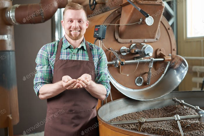 Coffee Roaster Posing by Machine