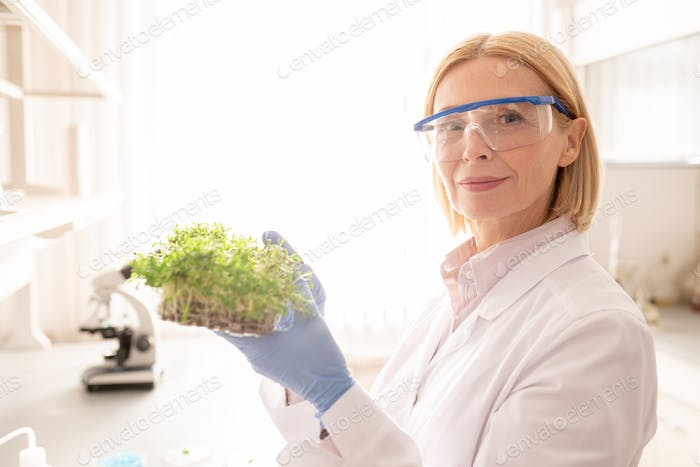 Mature lady exploring seedling