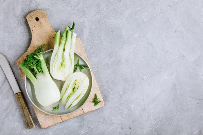 Fresh raw organic florence fennel bulbs or fennel bulb on gray stone background.