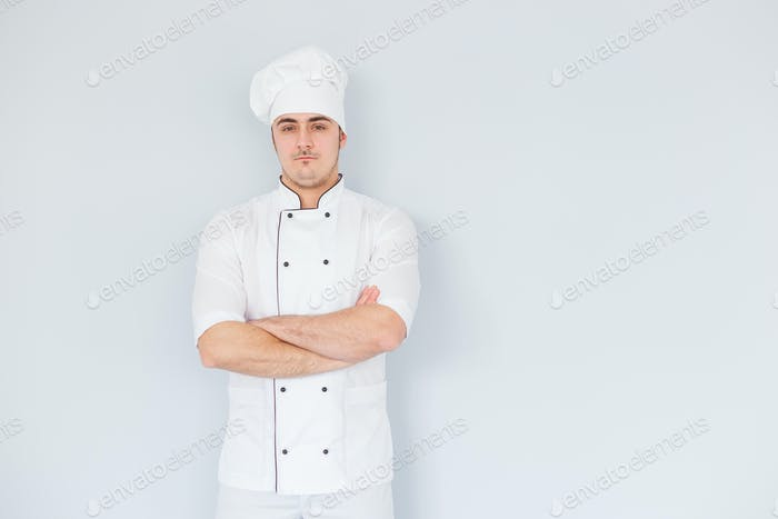 Pleased chef looking confidently at the camera. Professional approach to business