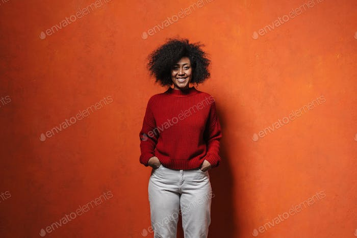 cheerful young african woman wearing sweater posing