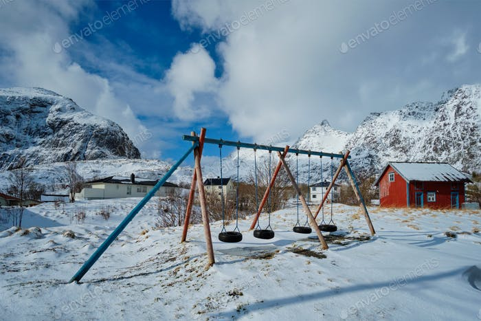 Children playground in winter. A village, Lofoten islands, Norway
