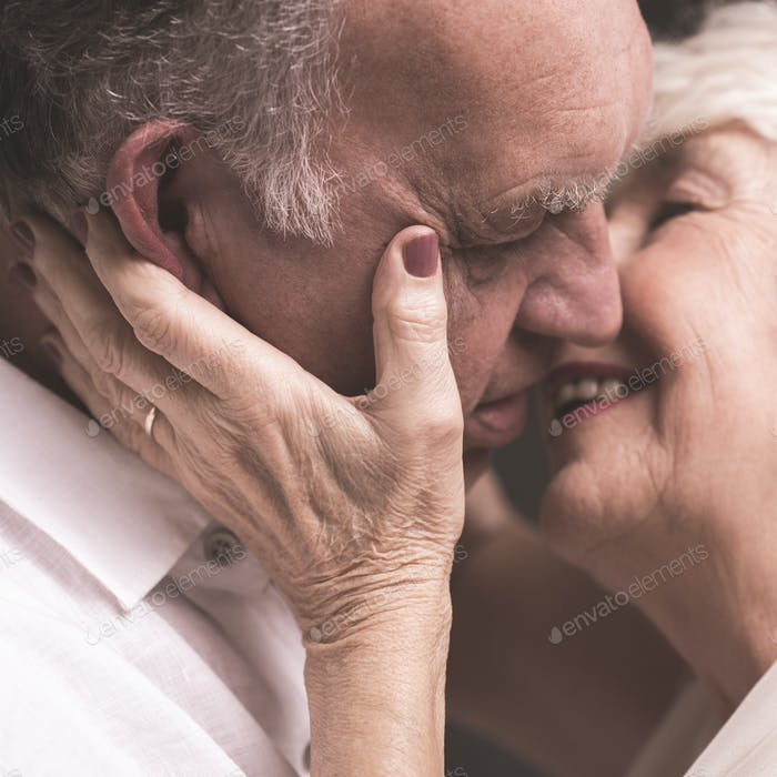 Happy senior couple kissing