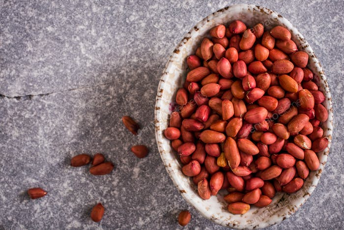 Bowl of shelled peanuts above