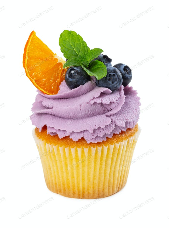 Cupcake with fresh blueberries, slice of orange and mint