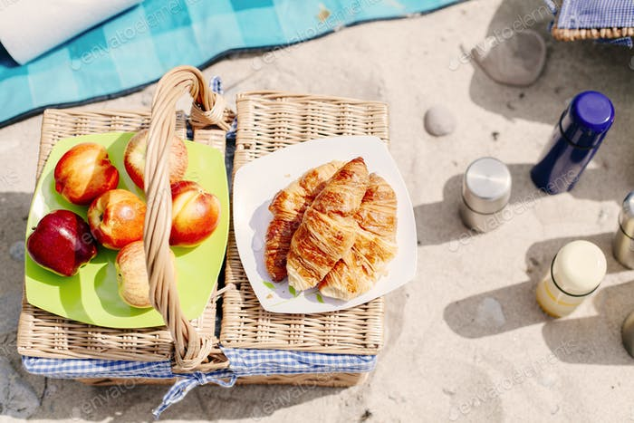 Food and drinks basket on beach