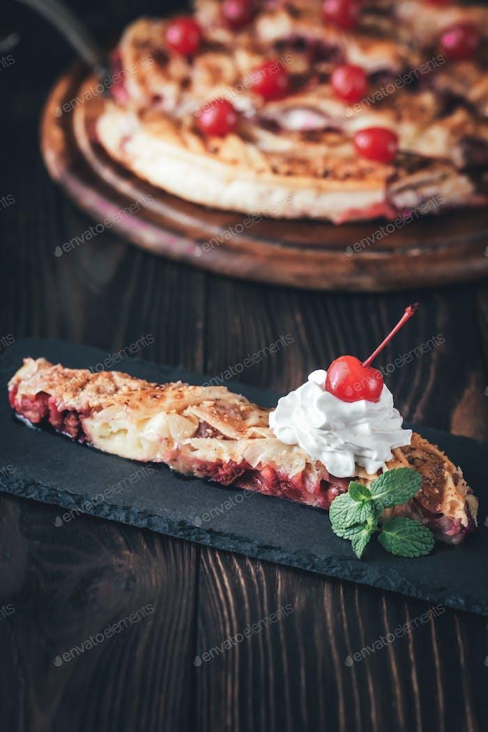 Portion of cherry custard pie