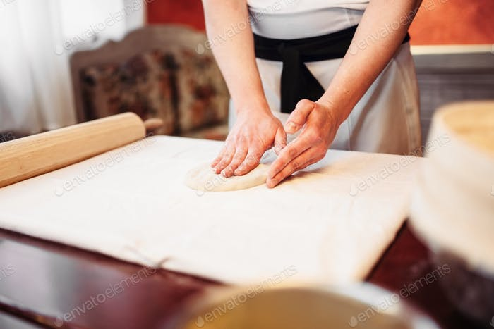 Male chef hands and dough, strudel cooking