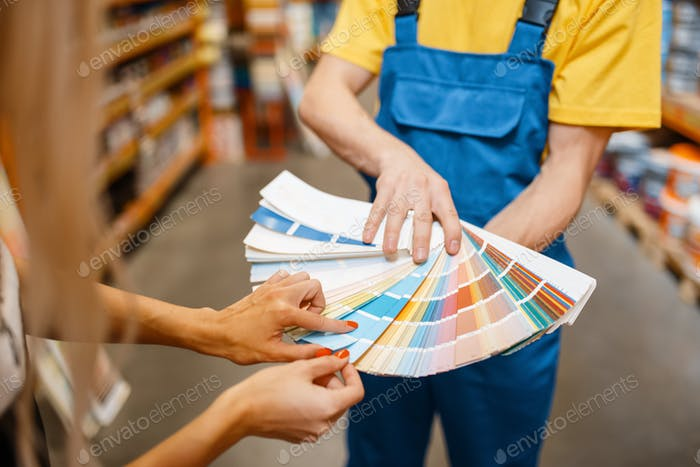 Assistant and customer with color palette, diy