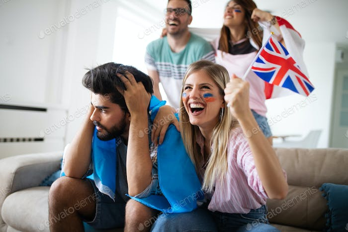 Group of football fans disappointed and happy watching a football game on the couch