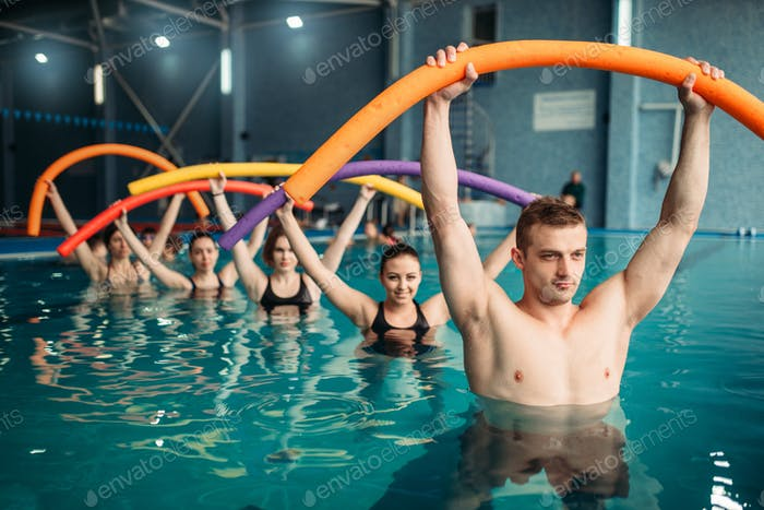Instructor and class on workout in swimming pool