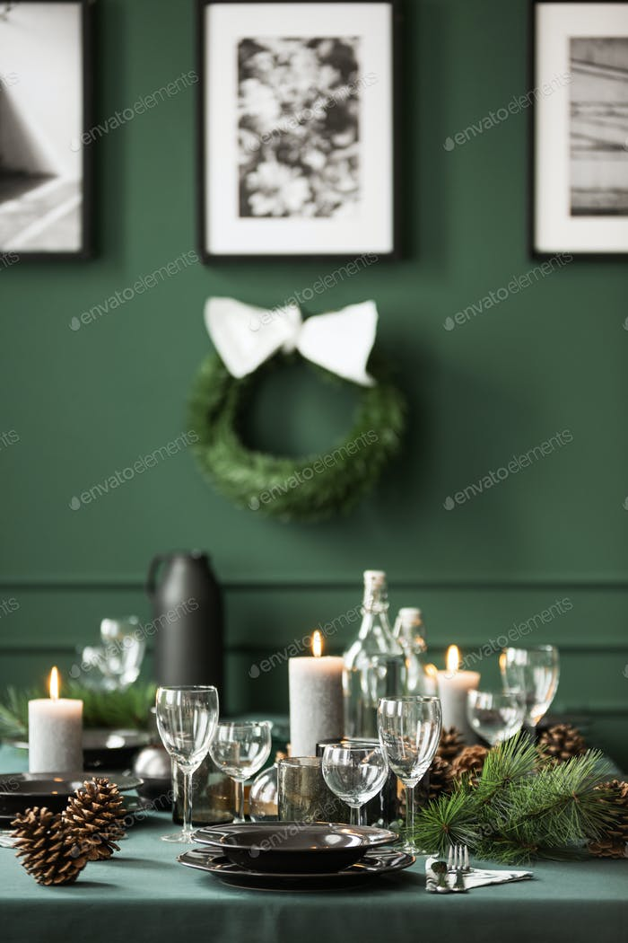 Vertical view of christmas garland and black and white posters o
