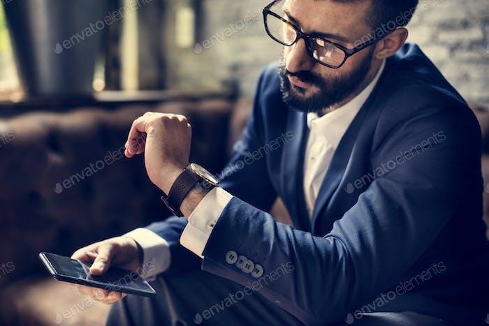 Classy man using mobile phone