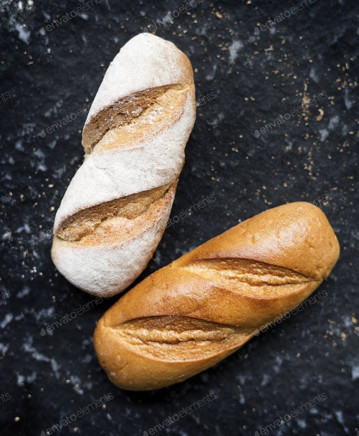 Two baguettes with black background