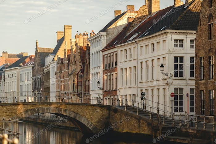 beautiful colorful houses, old bridge and canal in brugge, belgium