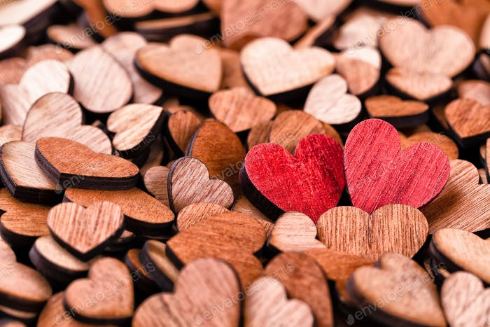 Background of wooden hearts,  red heart.