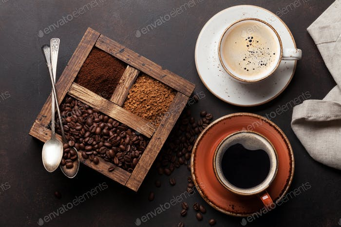 Coffee cup, roasted beans and ground coffee