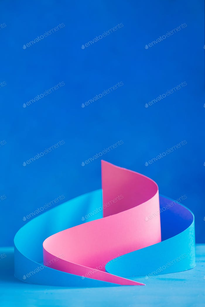 Papercraft shapes, pyramids, and curves in abstract paper sculpture. Design template with real 3D
