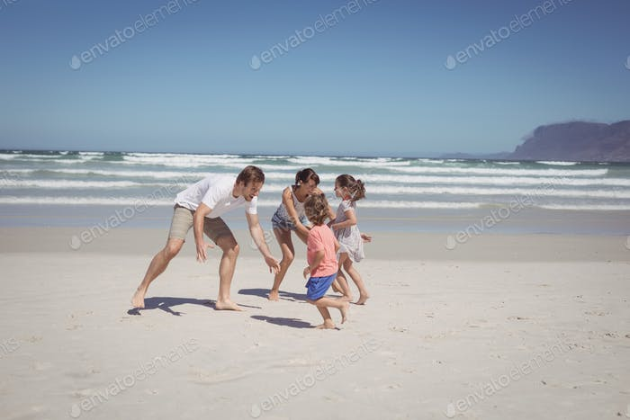 Happy family playing at beach