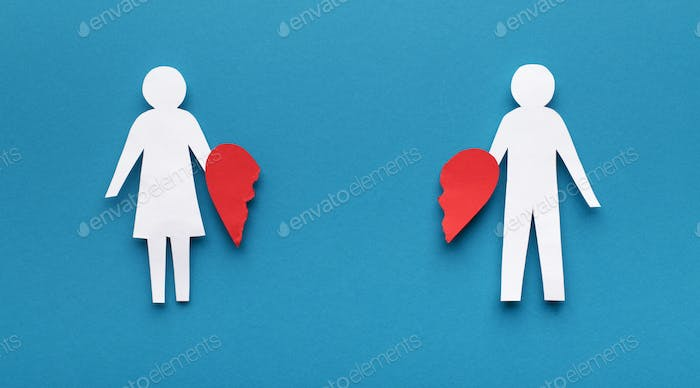 Papercut figures with broken heart on blue background