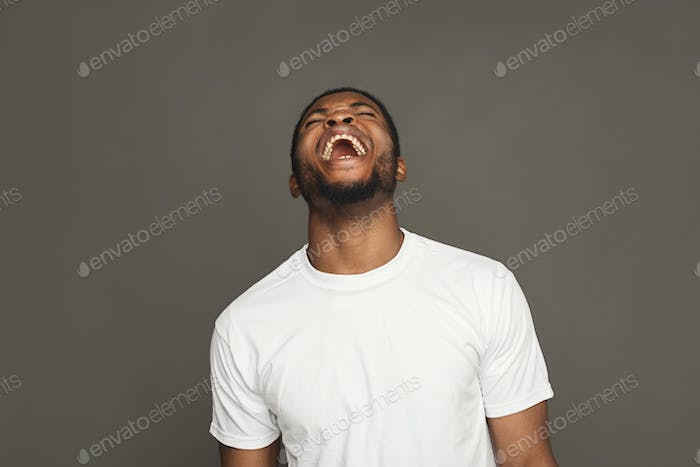 Facial expression, emotions, friendly black man laughing