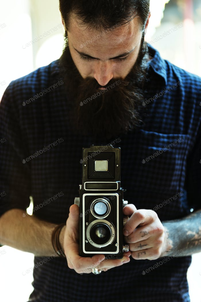 Photographer using a vintage camera