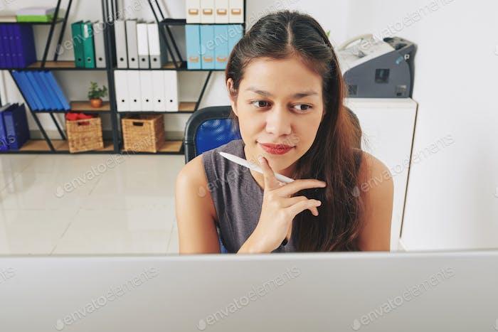 Businesswoman reading e-mails
