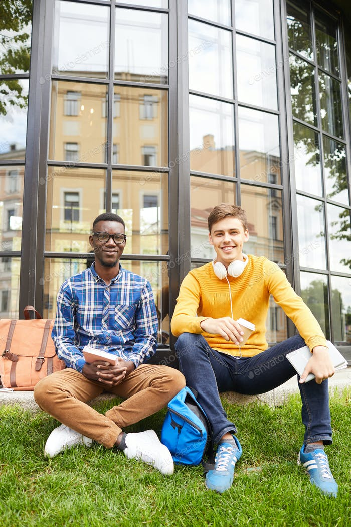 Two Students Posing Outdoors