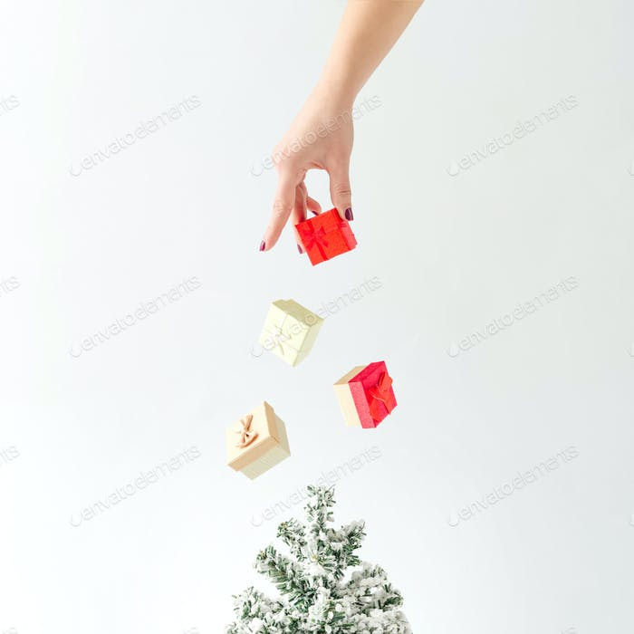 Creative concept. Christmas tree with gift boxes decoration.  Minimal new year idea.