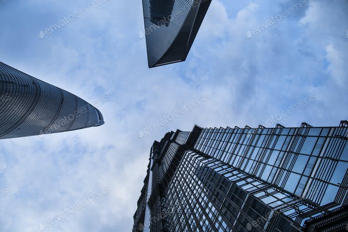 Low angle view of skyscrapers rising into the sky.