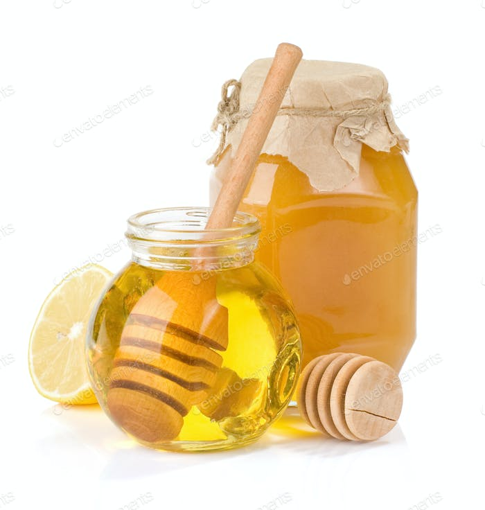 glass jar full of honey and lemon